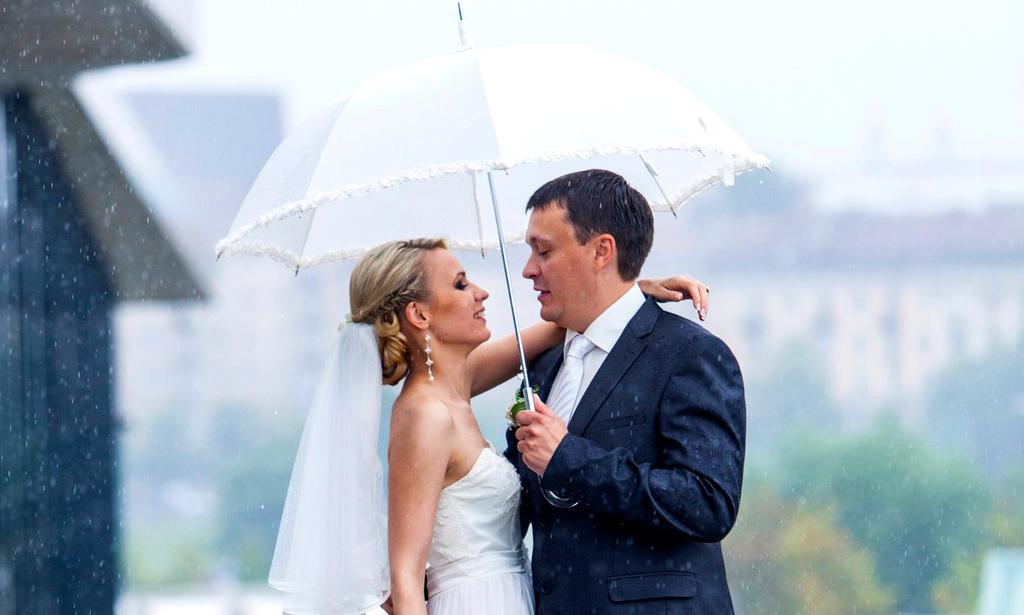 couple getting married rain