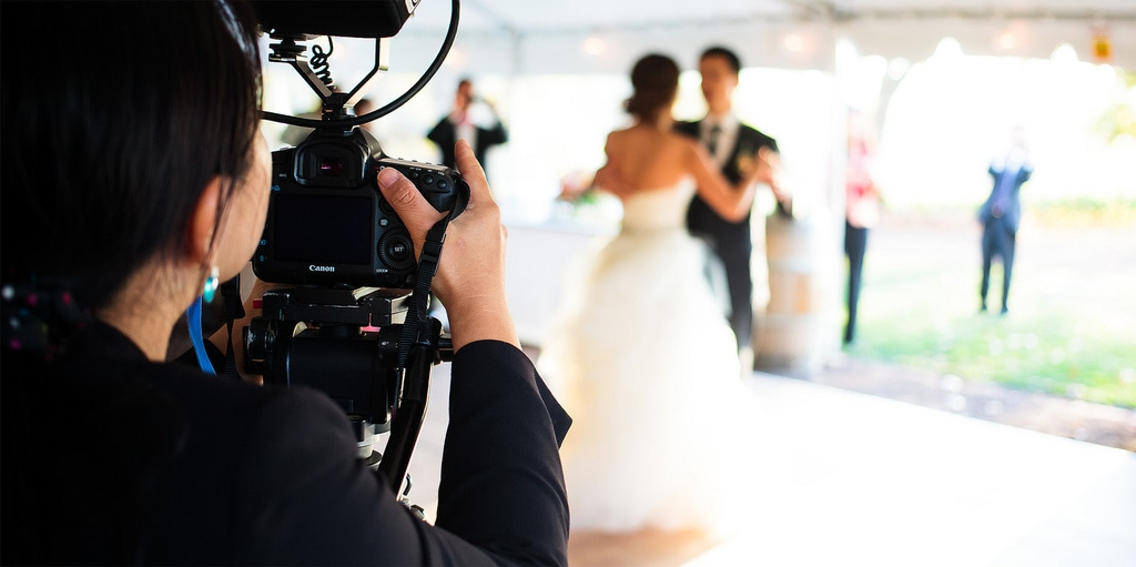 Videographer Shooting a Wedding Couple