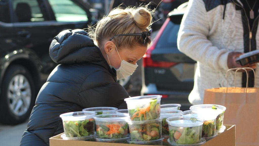 Emily Bugg serving Thanksgiving Day meals to those in need after she and her husband canceled their wedding.