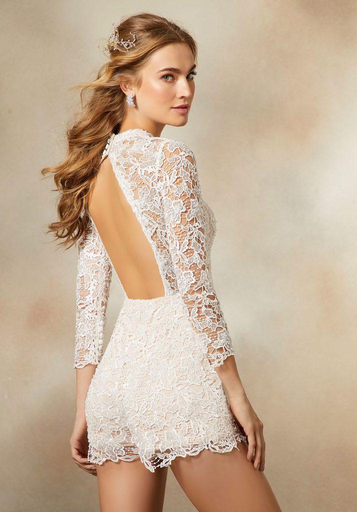 a model wearing a 'bodysuit' type wedding dress