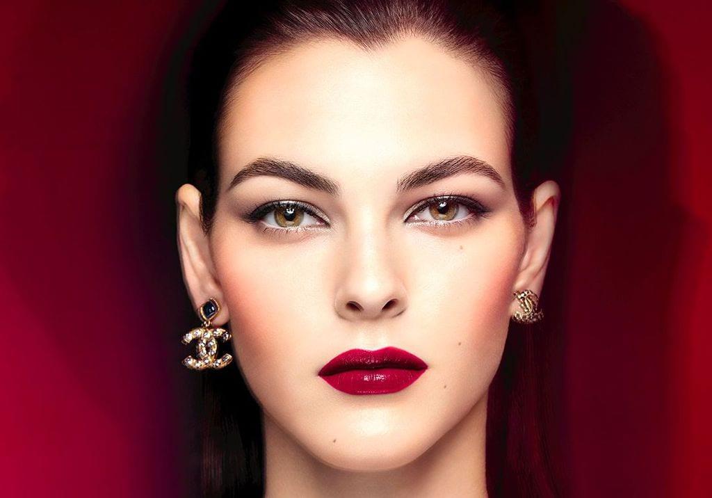a woman wearing Chanel earrings